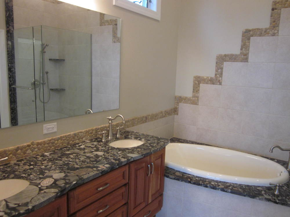 Granite countertops and natural stone tile.