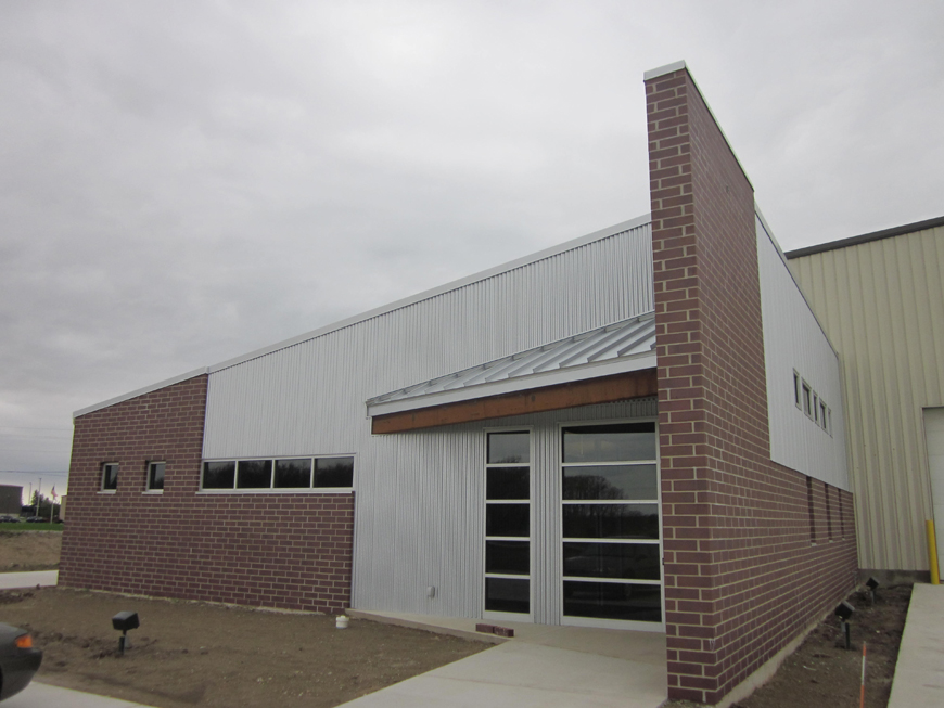 Built office building onto front of metal framed factory.