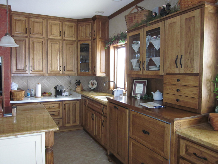 Remodeled kitchen with custom built cabinets, granite countertops and natural stone backsplash.