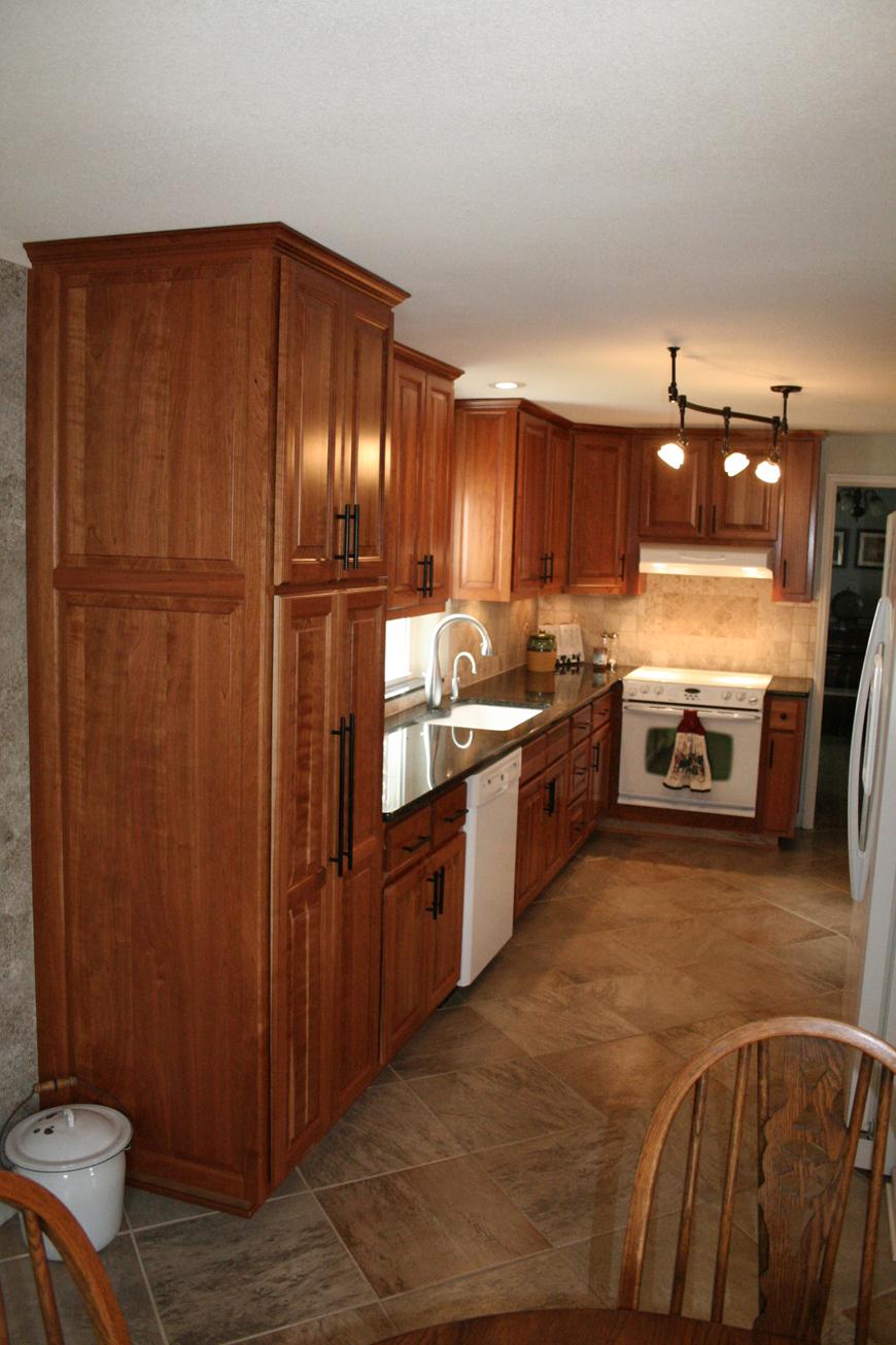 Custom built cabinets, granite countertops and natural stone backsplash.