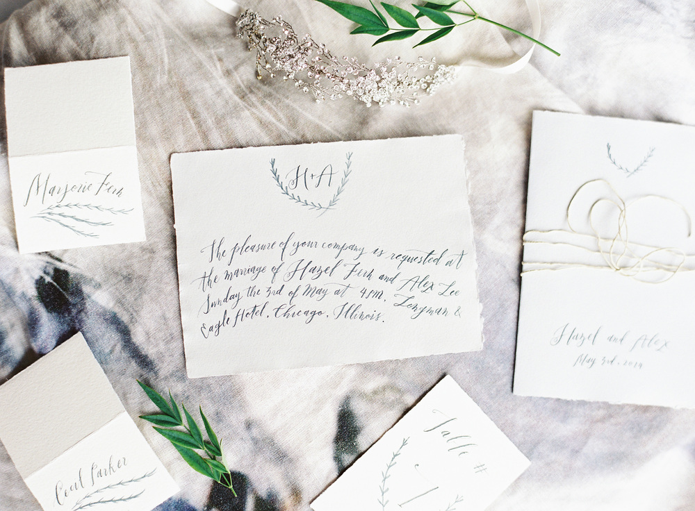 Photo by  Corinne Krogh Photography . Calligraphy by  Fox and Flourish . All handmade paper from Paper-Ya.