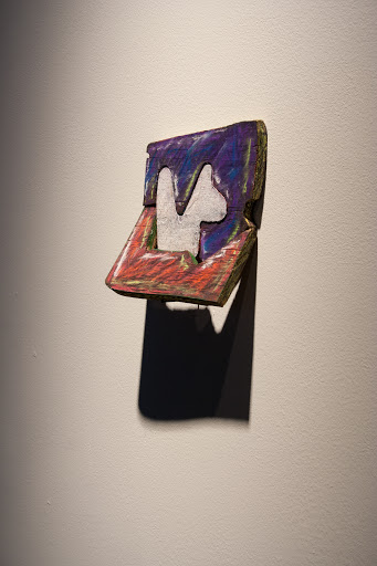 "Keith Allyn Spencer, Suggested Reading 2012, wood, pastel, paint (lots of fun), 5.5"" tall"