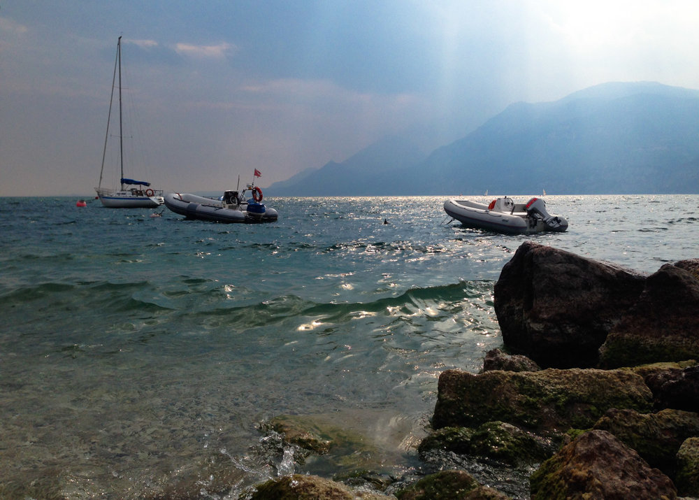 Lake Garda shore with boats on the water
