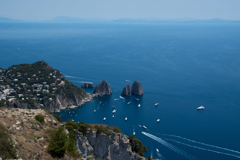 View of Capri Italy and Faraglioni three towering rock formations
