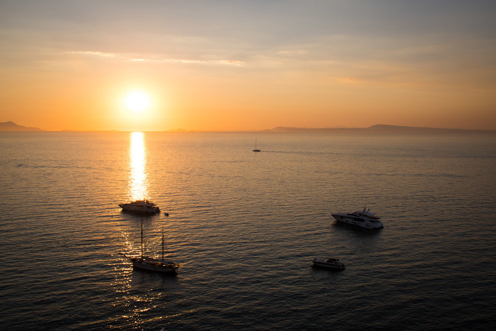 Sunset over Sorrento Italy with boats on the water