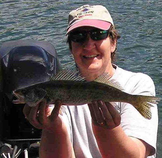 Lynn with her first walleye. She caught it in the Blue Creek area near Porcupine Bay.