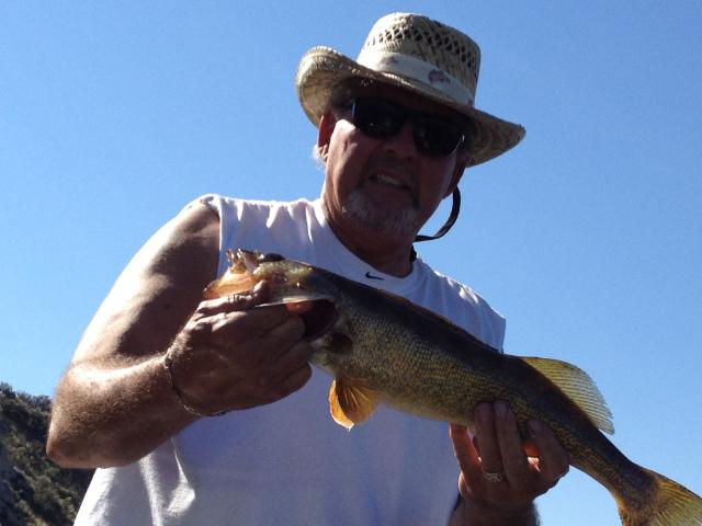 "Ken with a 21"" walleye from Rufus Woods. The hat was supplied by the Spokane Otter Watching Club."