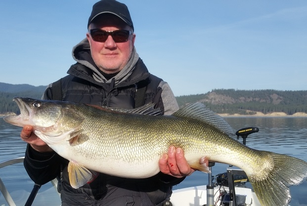 Cal's buddy Kirby with a Roosevelt monster weighing 15 pounds, 12 ounces.
