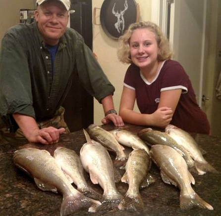 Travis and Hannah with 9 Snake River walleyes.