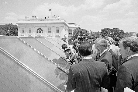 President Jimmy Carter, center, surrounded by reporters and photographers as he inspected new White House solar hot water heating system on June 20, 1979. (Harvey Georges - Associated Press)
