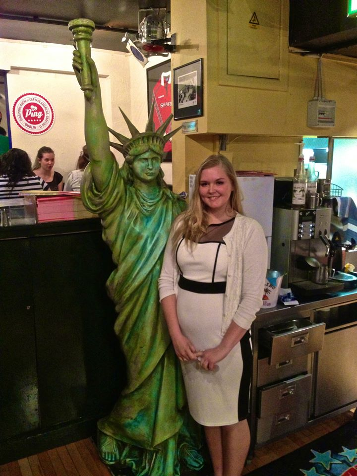 In Captain America with the statue of Liberty in my new dress:)