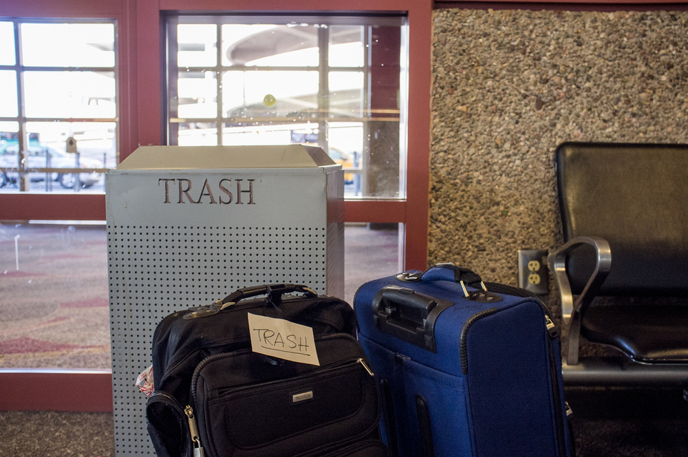 Where does the trash go? In the trash or in the trash? Or is the suitcase trash?