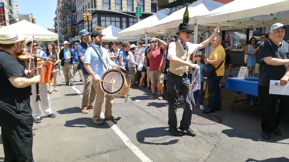 A Klezmer band parades down Eldridge Street.