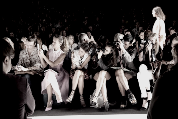 fashion bloggers sitting in the front row