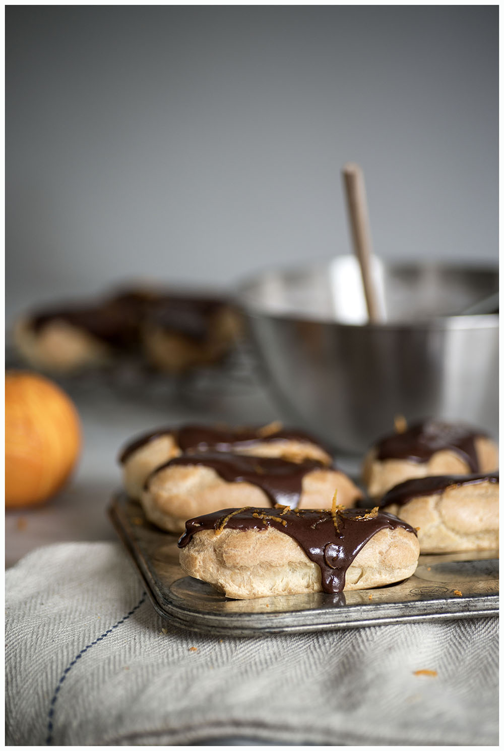 Orange and dark chocolate éclairs