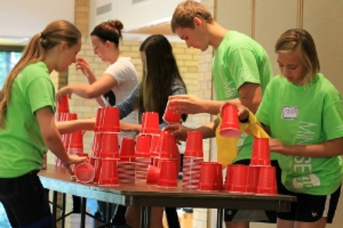 teenagers in a team-building activity as part of a 7 mindsets ultimate life summit. This photo and the ones below exemplify the 7 mindsets spirit of active youth engagement.