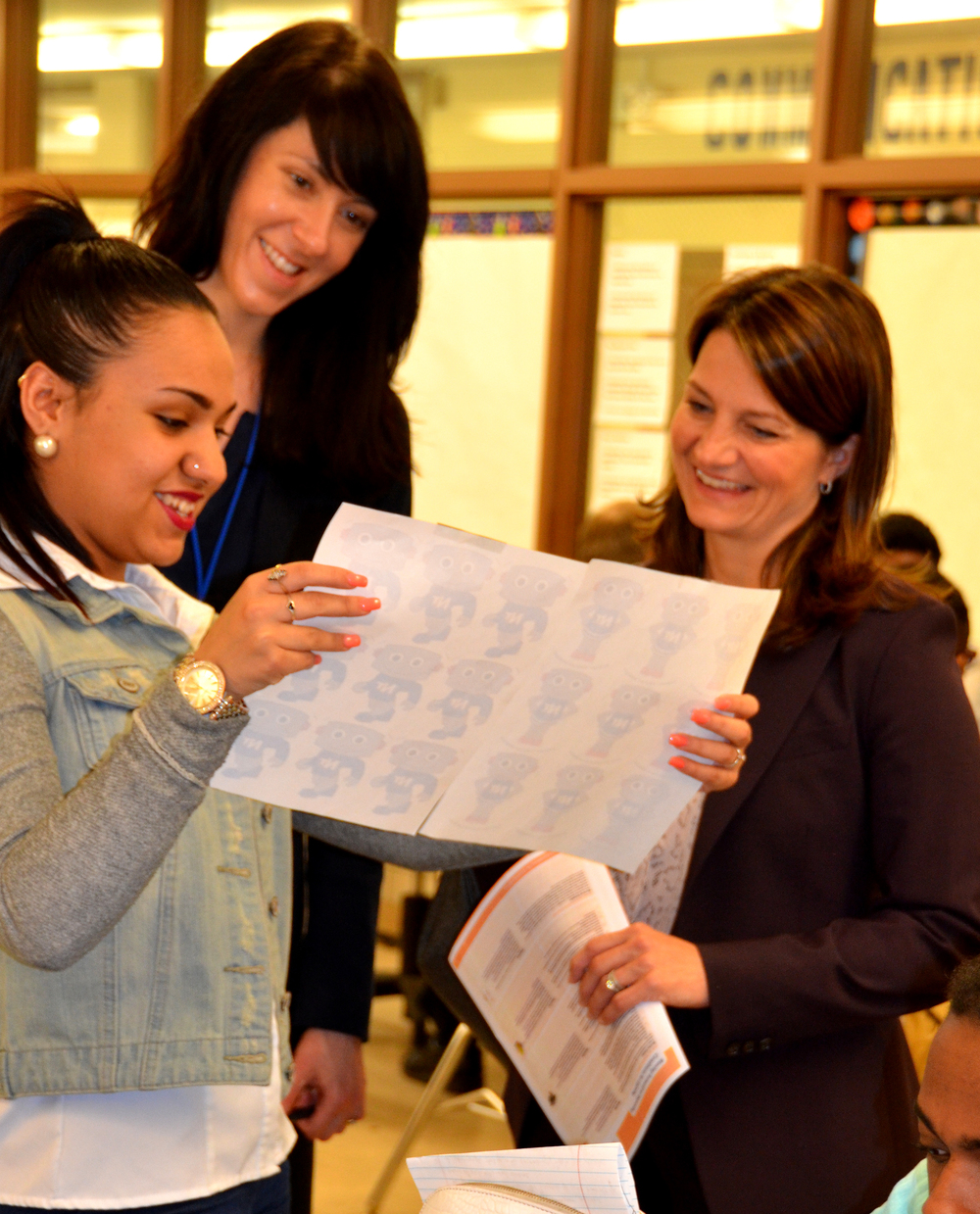 A cleveland student explains her project to amy mart, l. (chicago public schools), and karen niemi, r. (casel)