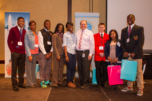 Cleveland's ceo eric gordon (center) with students from the sac and ctag programs.