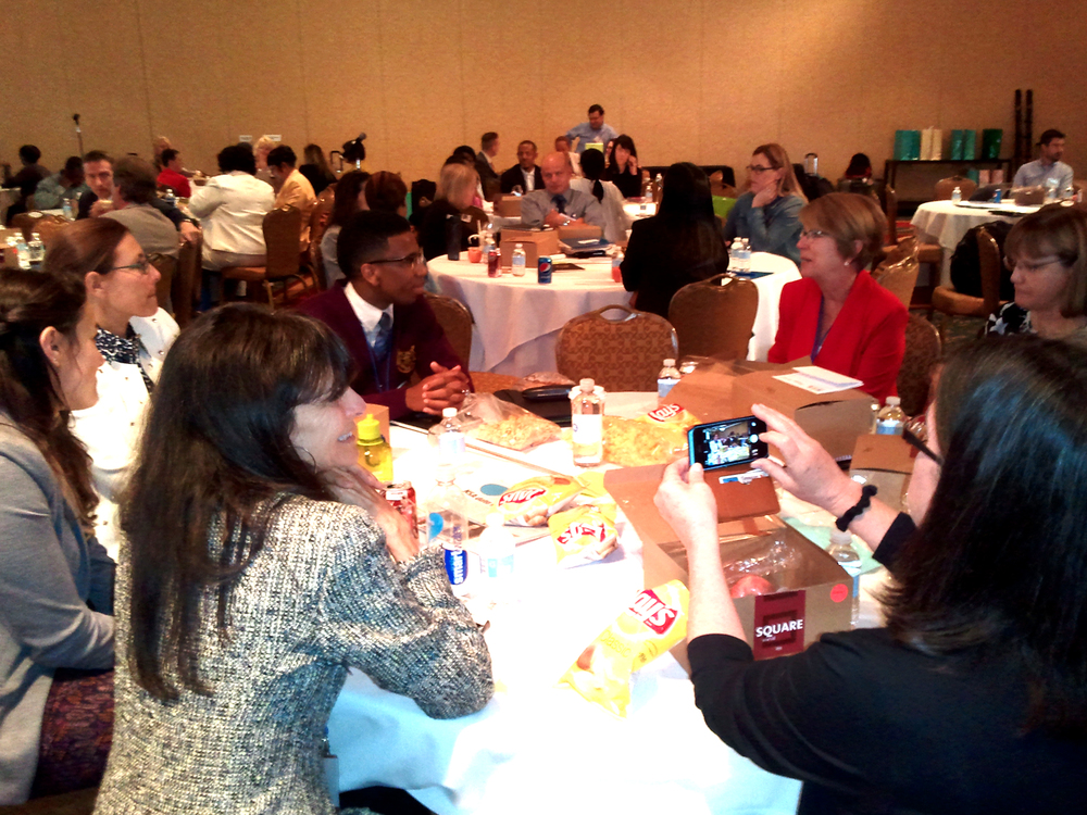 Instead of sitting up on the stage, the cleveland students engaged in conver-sation at the tables throughout the room.