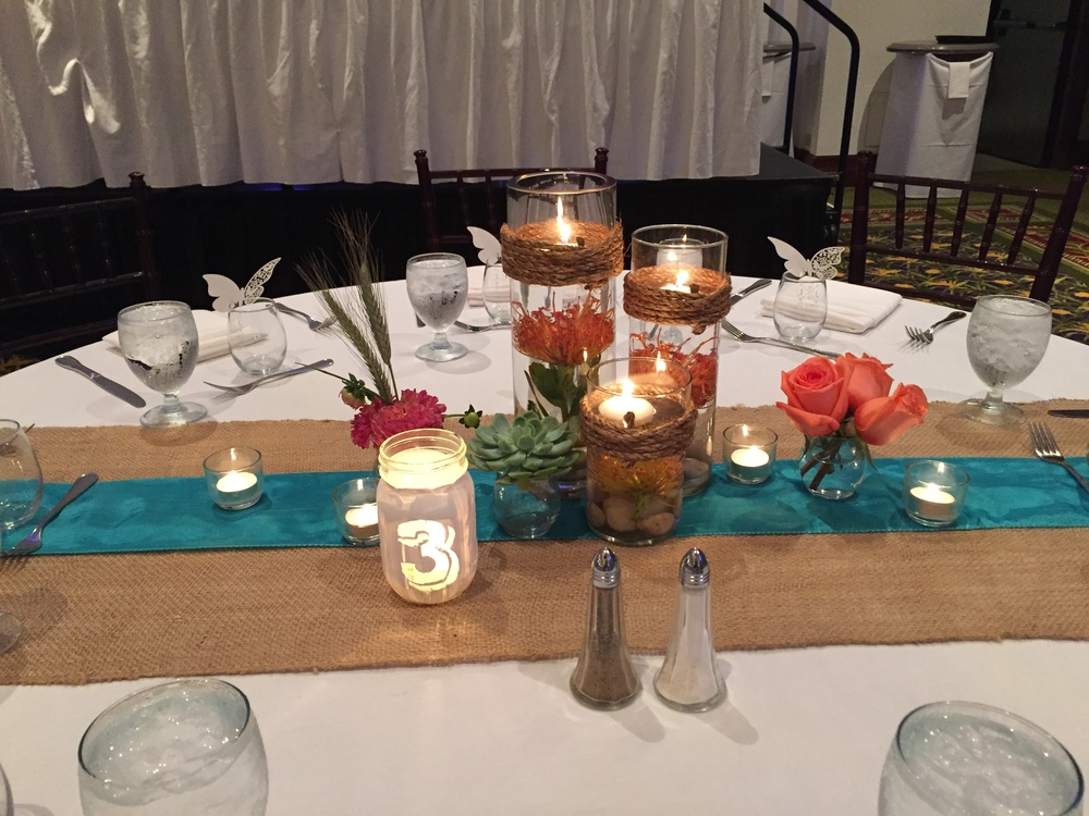 Featuring our burlap runner with turquoise sash for that rustic look