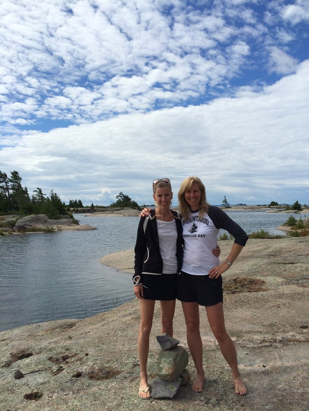Martha Ivester photo with sis on lake.jpg