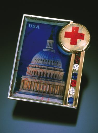 From 2001, an early brooch with a political narrative:   Creating the atmosphere suggested by its title, Concern is a brooch fabricated from sterling silver, 14 karat gold, a bezel set Red Cross pinback, channel set synthetic red, white, and blue stones, and a resin encased postage stamp.