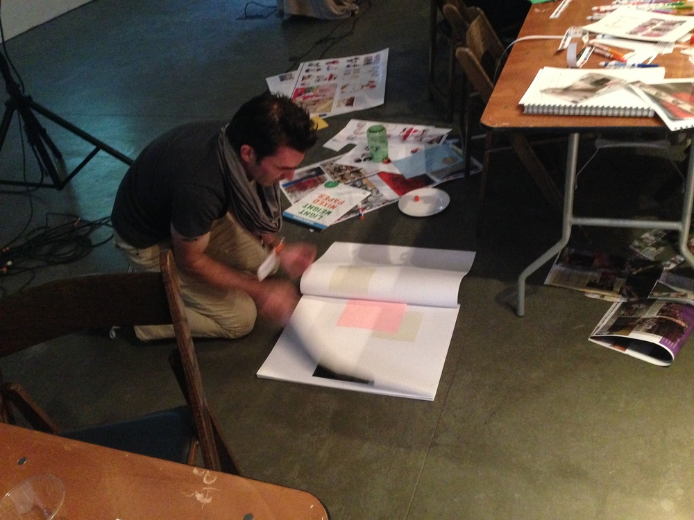 Conference symposiarch/curator Christopher Simmons building the beautiful big book in response to the music