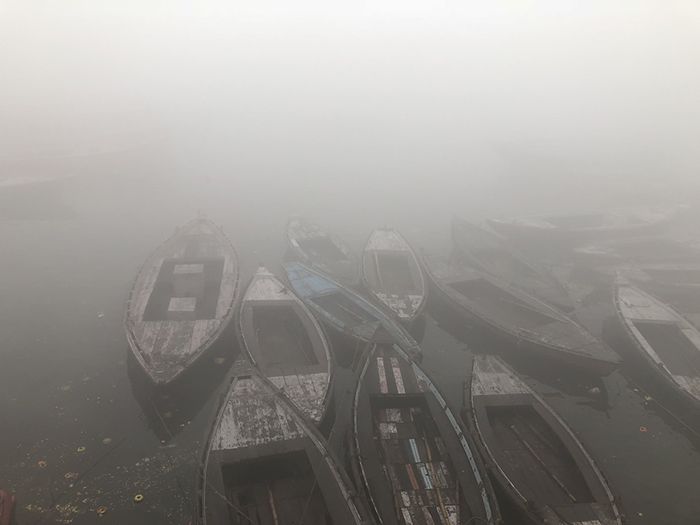 {Boats at dawn in Varanasi, India, taken January 2018}