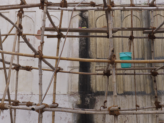 Turquoise bucket on scaffolding, India (2018)