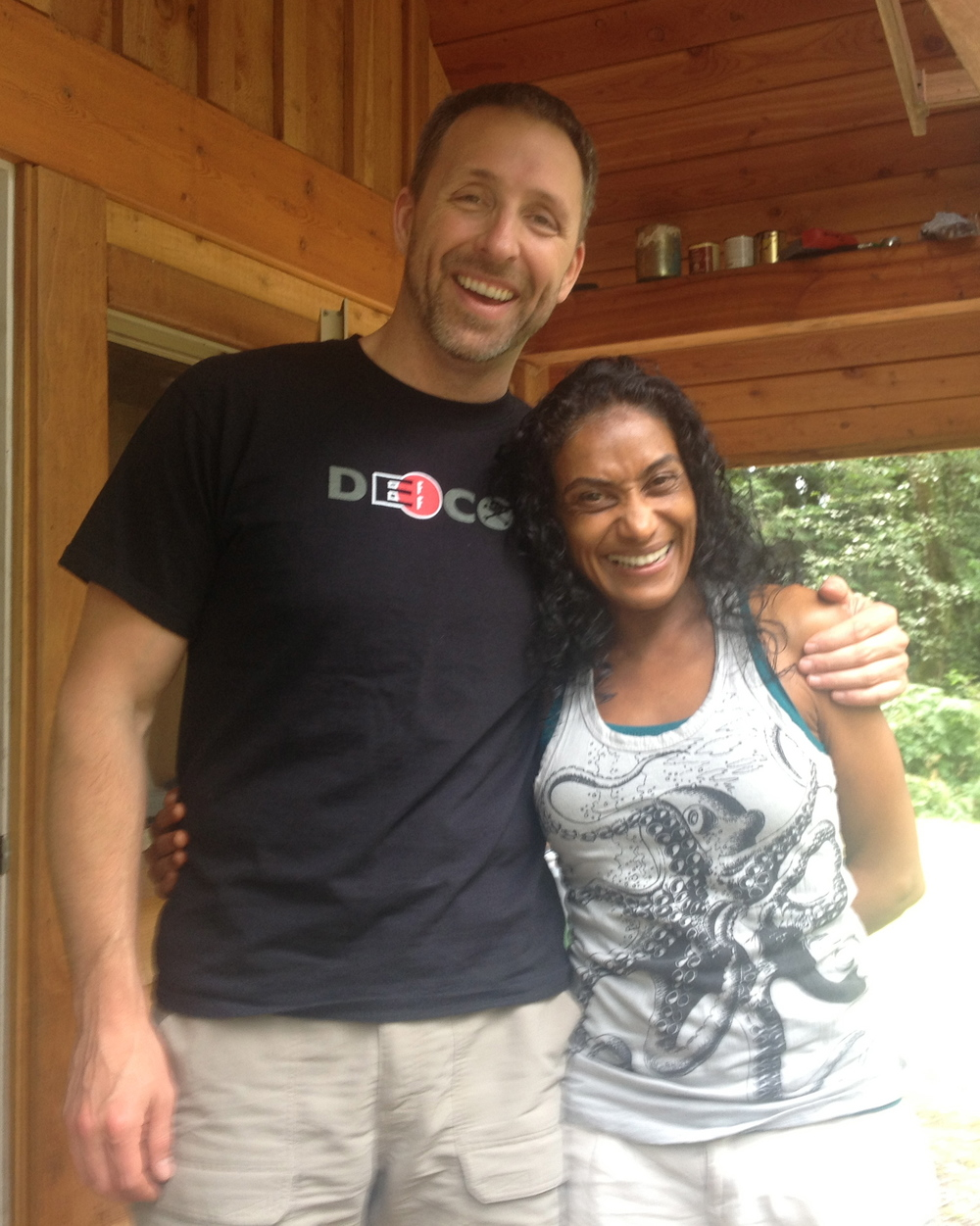 Dave Asprey and Cacilda (wearing one of her SureDesign t-shirts!) at his bio-hacking lab (aka man-cave).