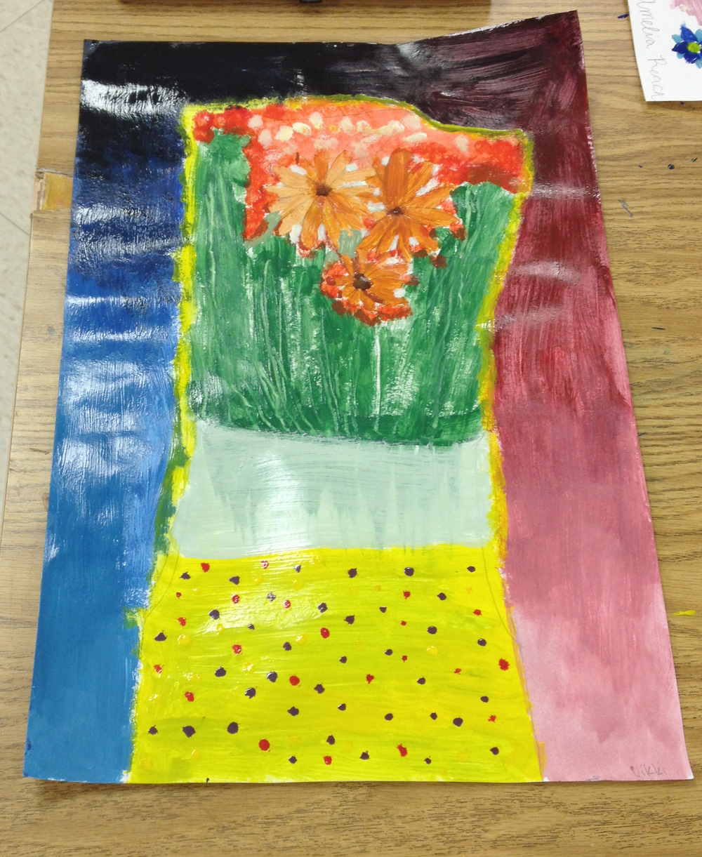 This student was really creative with her background. I was really impressed with that rainbow roll (a printmaking term). She imagined her own carrier for her flowers.