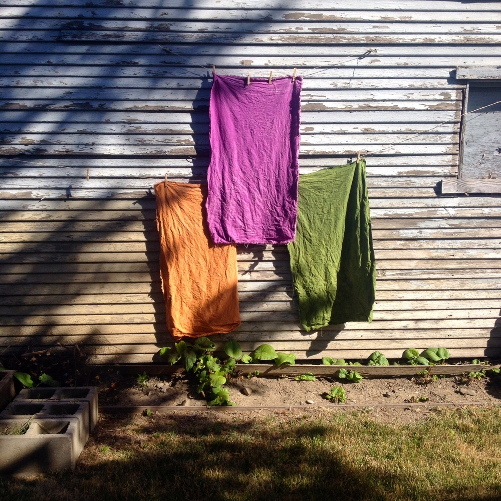Tangerine, lilac and avocado fabric drying.