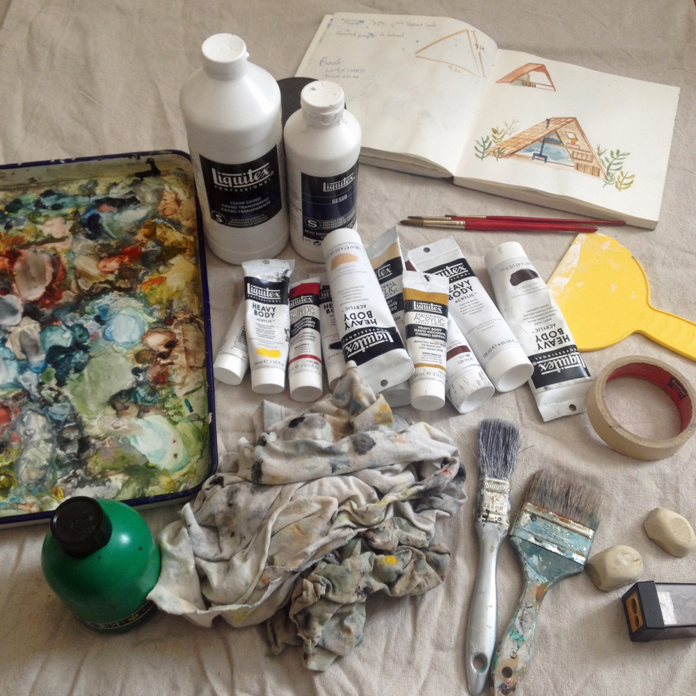 Palette, Sumi ink, gesso, paint, rags, sketchbook, brushes, masking tape, erasers and pencil sharpener on a drop cloth all  headed to Cinequest.