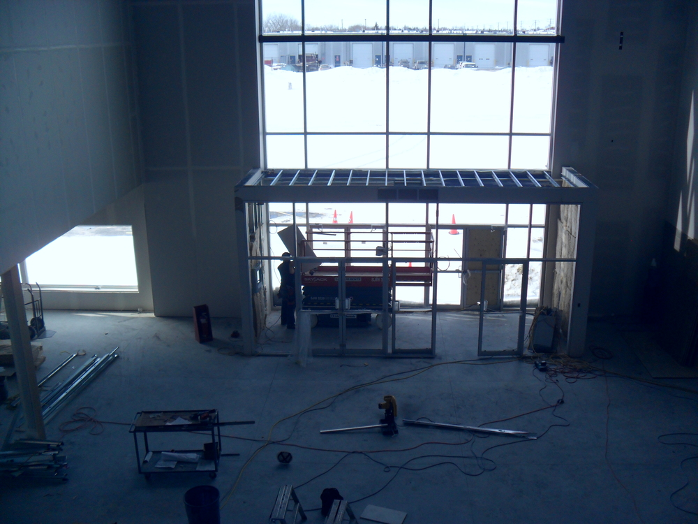 Getting ready to lift sheets of drywall for the vestibule bulkhead.
