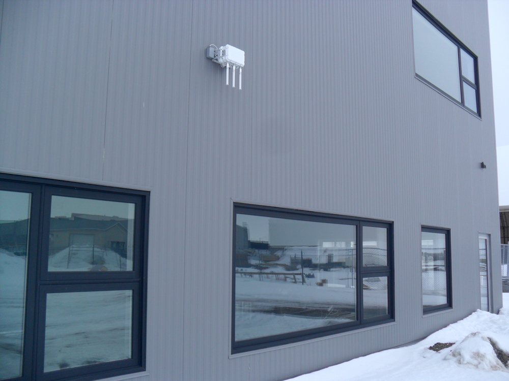 The white box above is one of three exterior access points for broadcasting the internet outside the building.