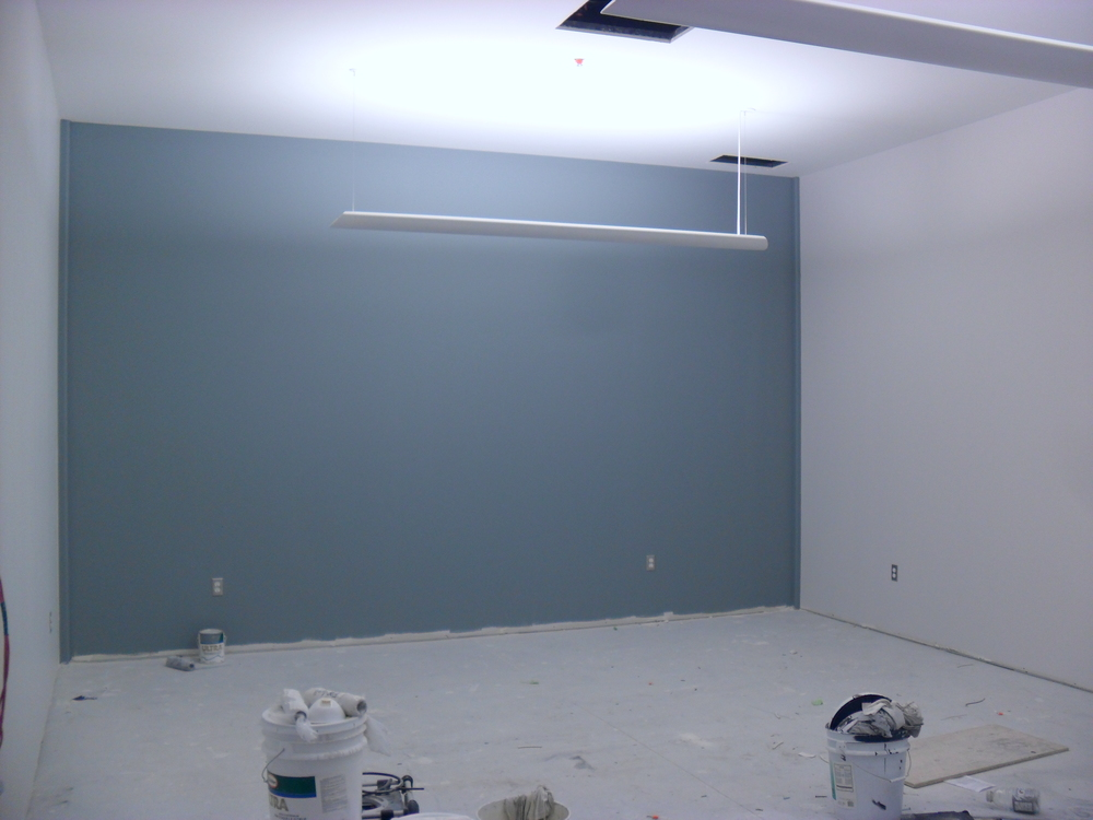 The office reception area with the back wall painted 'Brewster Gray'.