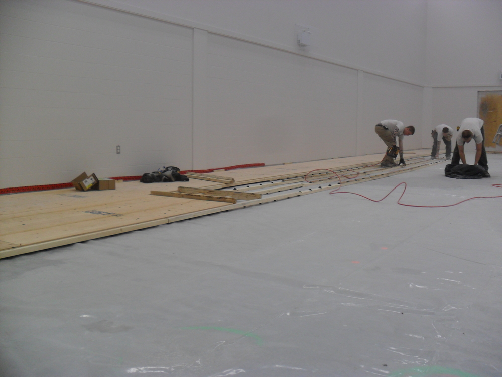The guys started installing the subfloor.