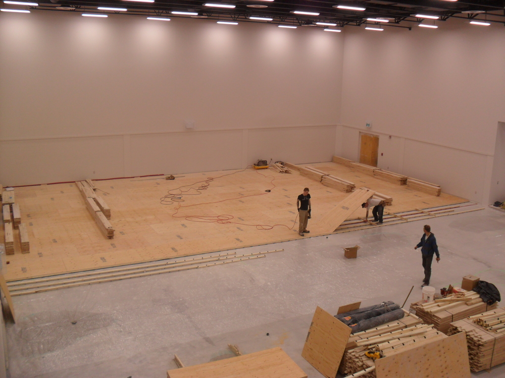 Almost 1/3 of the gym's subfloor has been installed.