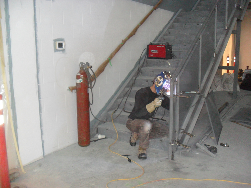 Welding the last of the stair rail panels.