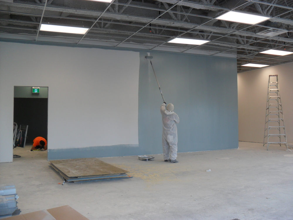 Painting the feature wall in the Coffee Room area.