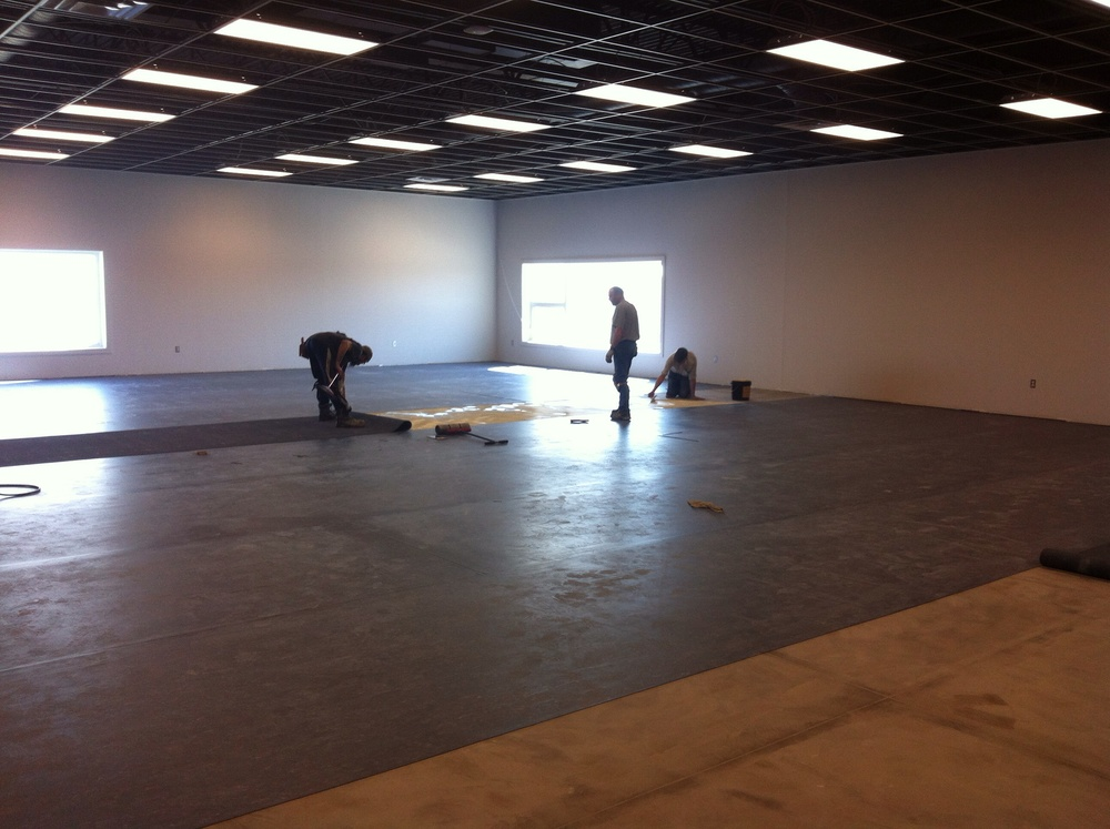 Vinyl is getting glued to the concrete in the Youth Room