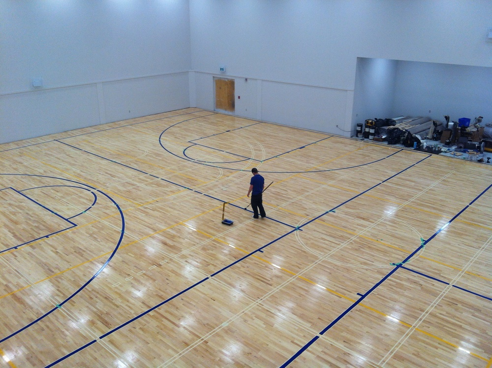 Cross-court basketball lines are getting painted