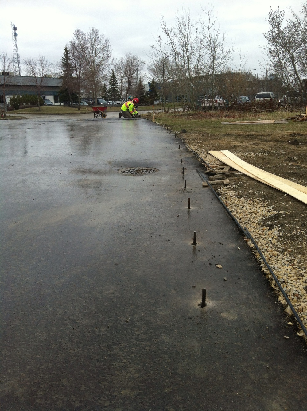 Rebar pins installed to reinforce the concrete curbs.