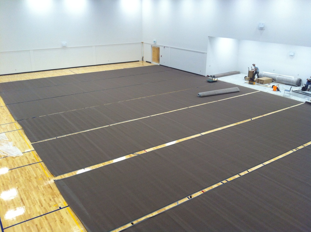 Getting ready to stitch the carpet edges.