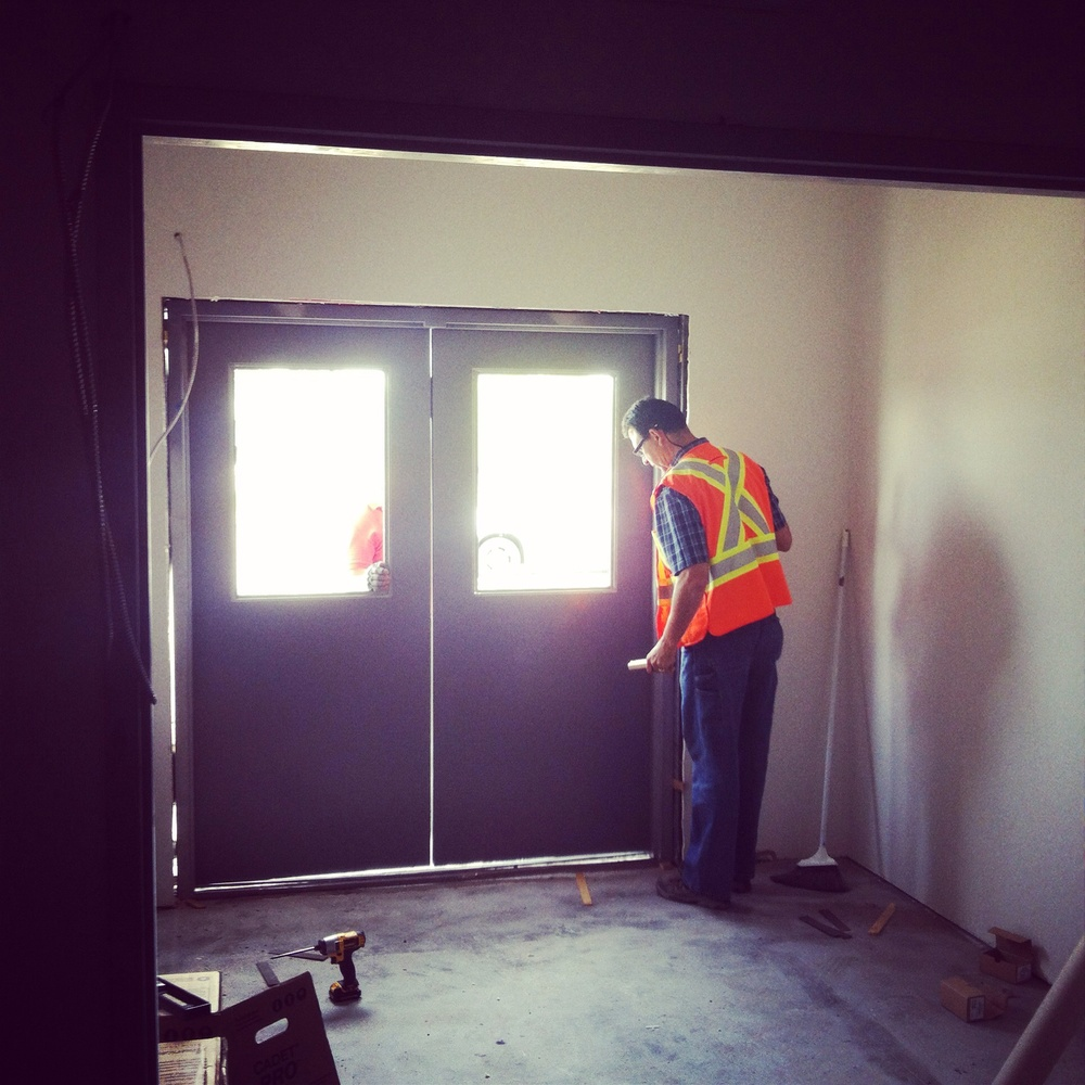 The temporary aluminum doors have been replaced with steel doors that are fire rated.  Safety First!