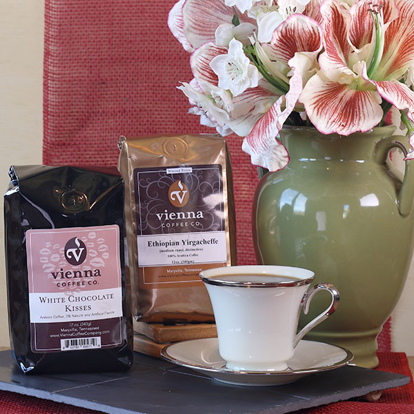 Shower your sweetie with kisses this month and make her/him a steamy mug of our White Chocolate Kisses flavored coffee or our featured Ethiopian Yirgacheffe Coffee.
