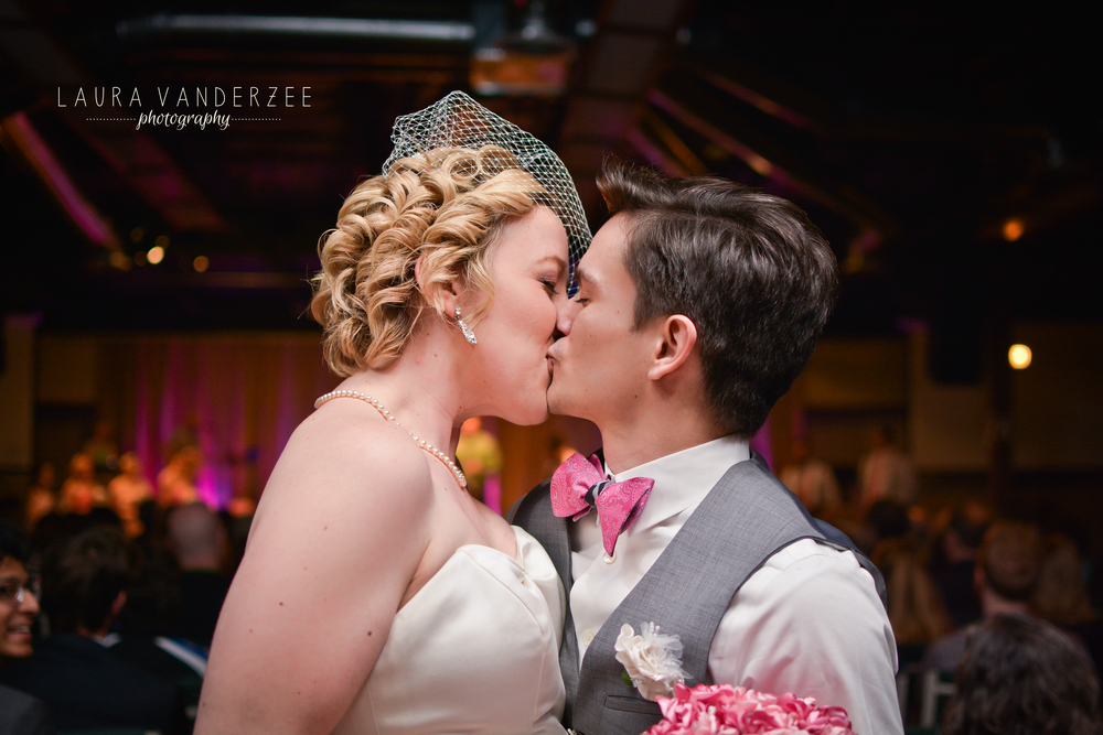 One of my favorite things to do at weddings is to get a kiss at the end of the aisle!