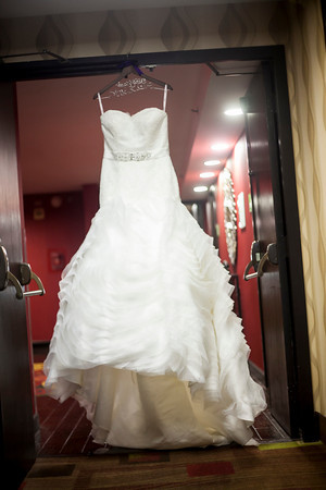 The brides BEAUTIFUL dress was form fitted just for her and purchased at Evan Grace Boutique in Concord NC.