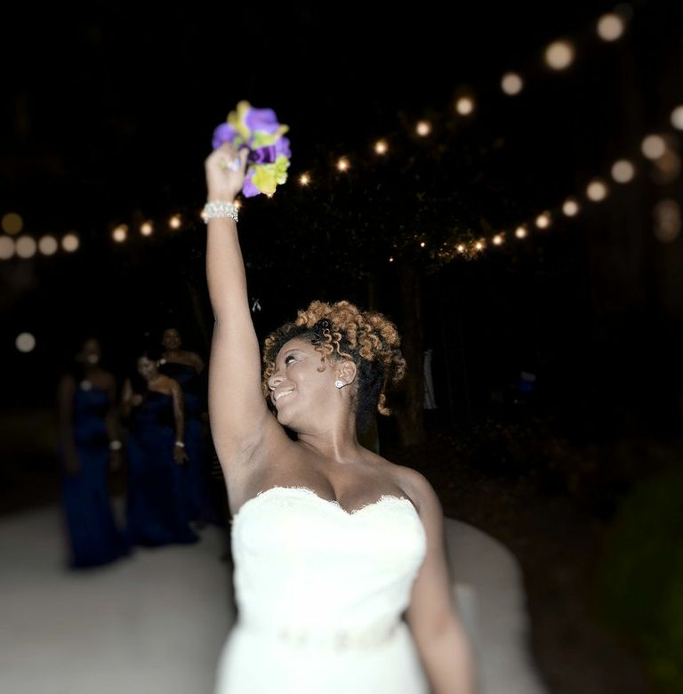 Stunning picture of the bouquet toss by Will Saunders of Freeverse Freelance Photography.