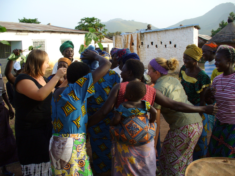 Dancing with the ladies in her community